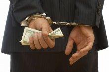 Handcuffed Banker